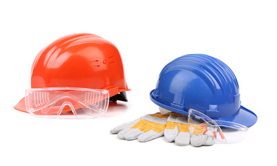 Two hard hats with working gloves