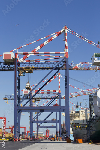 Cranes and container ships at commercial dock