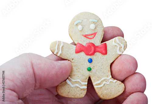 Smiling gingerbread men in a hand