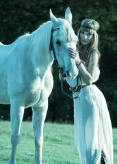 Portrait of a white horse and woman