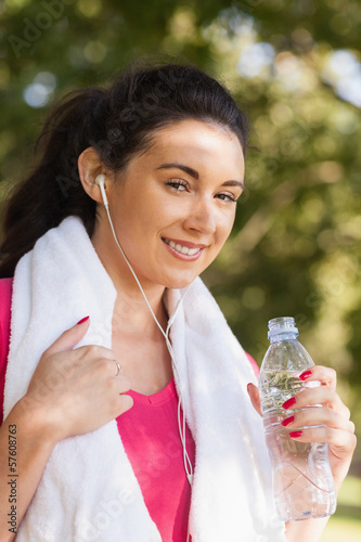 Cheerful young woman posing in a park