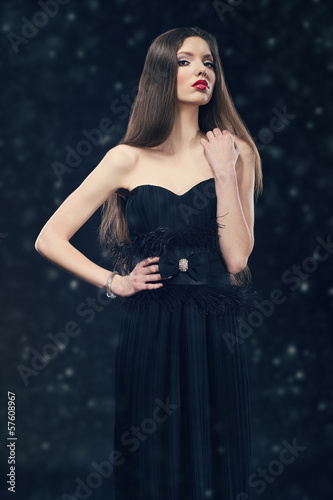 photo of a glamour woman wearing black evening dress