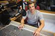 Handsome cheerful radio host moderating