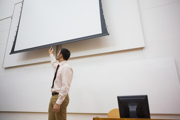 Teacher with projection screen in lecture hall