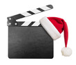 Clapper board with Santa's hat on it isolated on white - 57611765