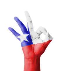 Hand making Ok sign, Chile flag painted