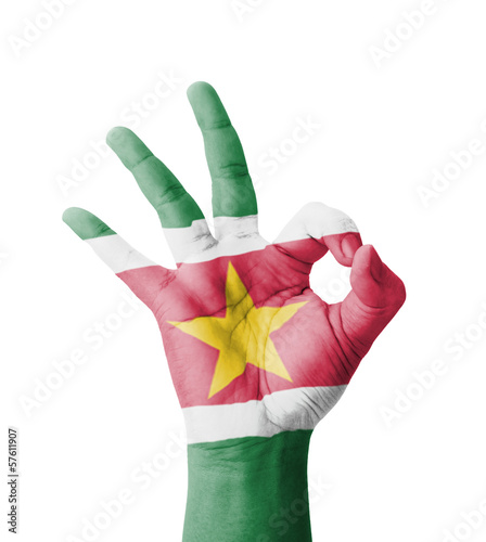 Hand making Ok sign, Suriname flag painted