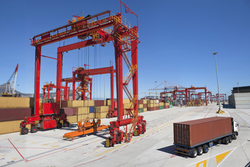 Lorry hauling cargo container at commercial dock
