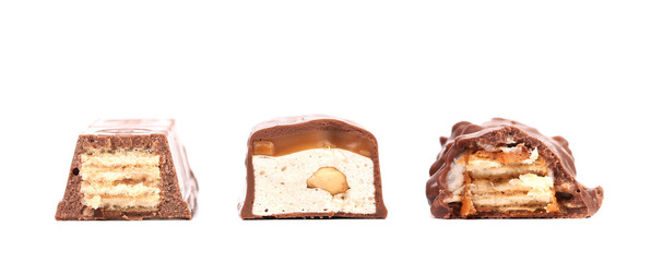 Different slices bar of chocolate. Close up.