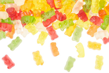 Gummy bears candies falling border on white, clipping path