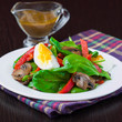 Fresh green salad with spinach, mushrooms, red pepper, egg