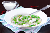 Chicken soup with green peas, pearl barley, chili pepper, food