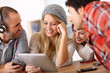 Group of teens using digital technologies