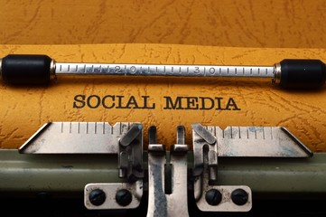 Social media text on typewriter concept