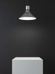 podium and lamp in dark room