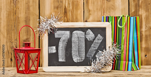 seventy percent discount written on blackboard with christmas de