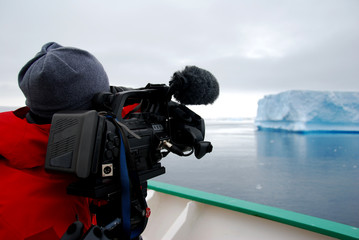 cameraperson filming an iceberg