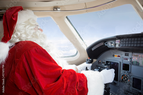 Santa In Cockpit Flying Private Jet - 57615719