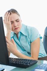 Classy wincing businesswoman having a headache