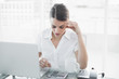 Attractive focused businesswoman working sitting at her desk