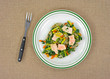 Cooked TV dinner of salmon and vegetables on plate with fork