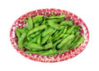 Cooked edamame pods in a red serving dish