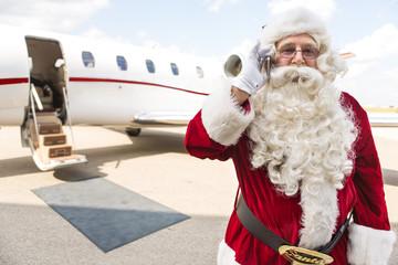 Santa Using Mobile Phone Against Private Jet