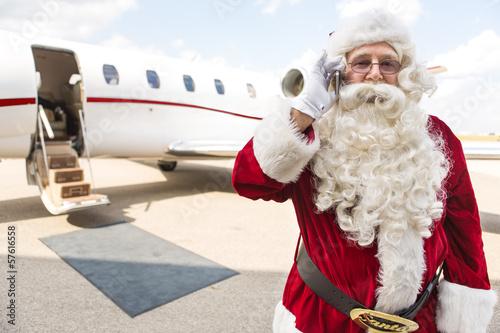 Plexiglas Luchthaven Santa Using Mobile Phone Against Private Jet