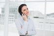 Elegant businesswoman using cellphone in office