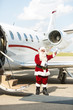 Santa Using Waving Against Private Jet