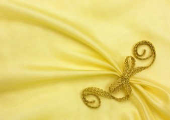 background of golden organza draping