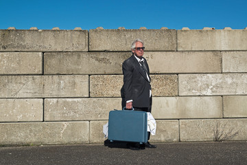 Lonely wandering depressed senior business man with sunglasses w