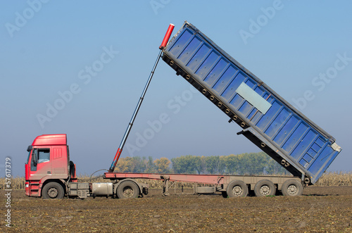 Agricultural truck tipping on field