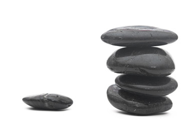 Balanced stack of stones isolated on white. Zen design concept