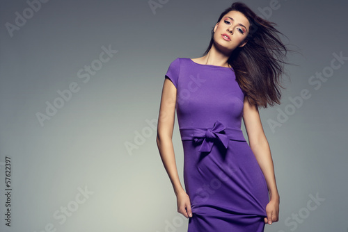 picture of young beautiful woman wearing purple dress