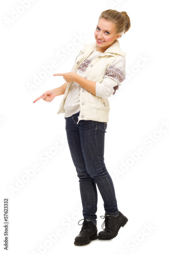 Young smiling girl shows pointing gesture