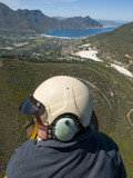 Man flying over Hout Bay, Cape Town, South Africa