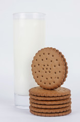 Round biscuits stack with glass of milk