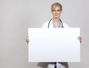 female doctor holding board