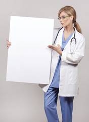 female doctor holding board