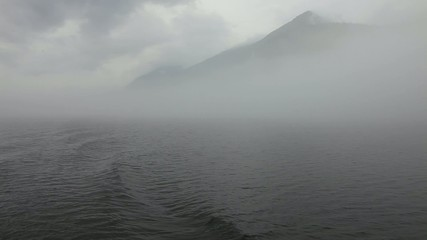 Mountain disappears in the fog.
