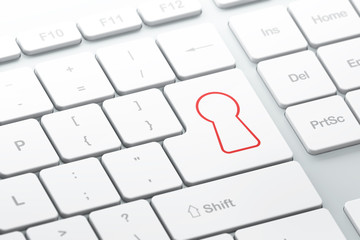 Safety concept: Keyhole on computer keyboard background