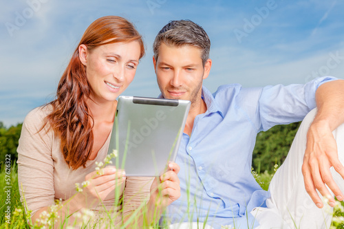 green couple with tablet