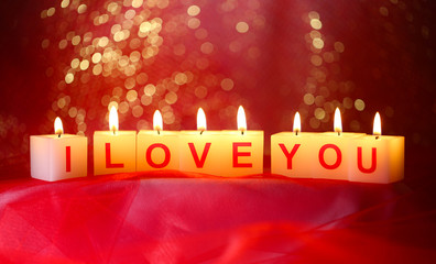 Candles with printed sign I LOVE YOU,on  bright background