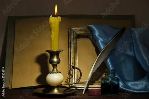 Old candle on table in room