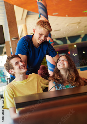 Three teens friends in cafe