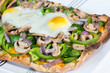 Fresh, hot baked Vegetarian flatbread pizza with 2 eggs sunny si