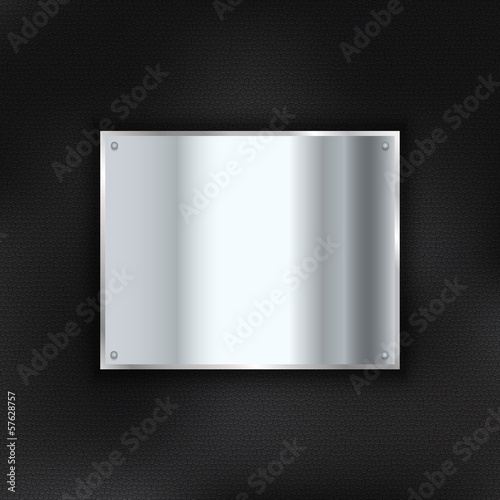 Metal plate on leather background