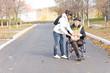 Daughter handing an elderly disabled man groceries