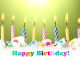 beautiful birthday candles  on green background